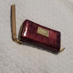 Michael Kors zip close wallet port wine in…